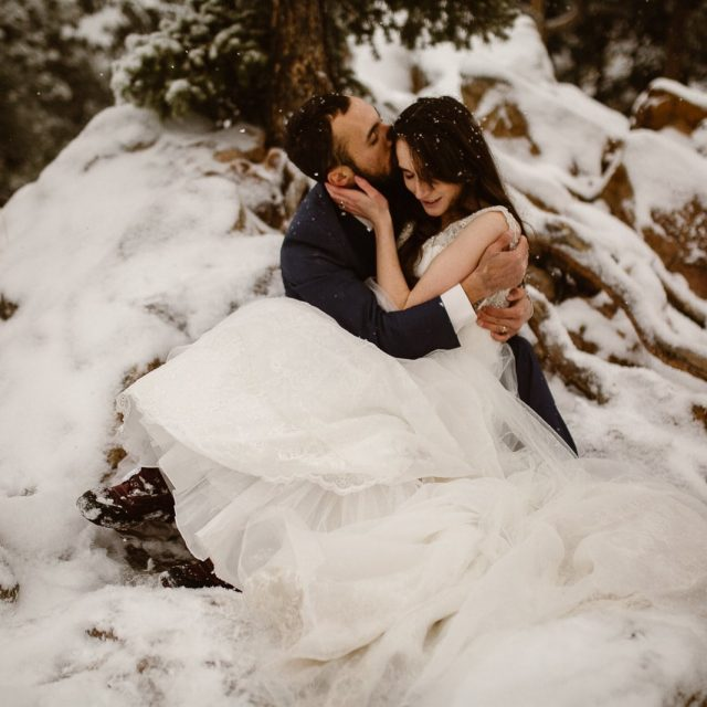Snowy, Cinematic, windswept, embraced in love adventures in Colorado, Justyna E Butler Photography, Colorado Adventure Wedding Photographer