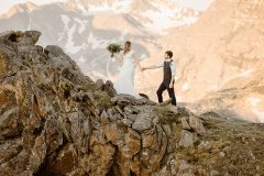Cinematic, windswept, embraced in love adventures in Colorado, Justyna E Butler Photography, Colorado Adventure Wedding Photographer