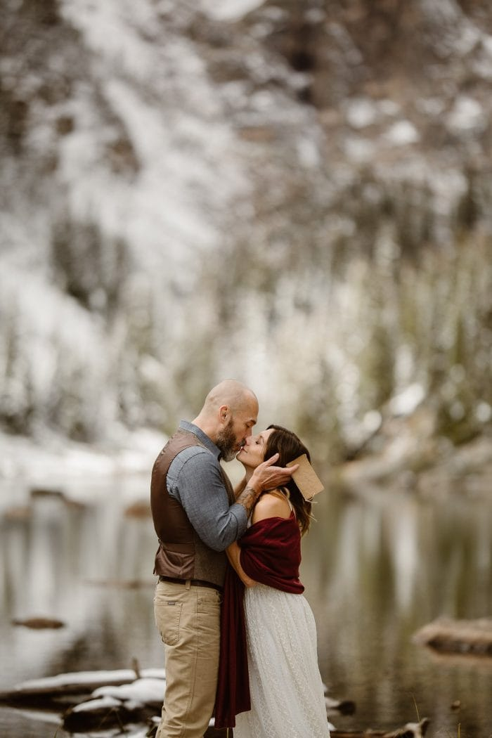 The adventure elopement couple is comiting their lives to each other at Dream, Alpine lake with freshly snowed covered alpine Colorado Rocky Mountain lake. INTIMATE WEDDING + ADVENTUROUS ELOPEMENT PHOTOGRAPHER | JUSTYNA E BUTLER