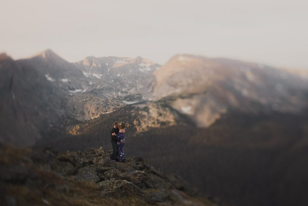Colorado couple in adventurous alpine surroundings at the top at 12000 feet