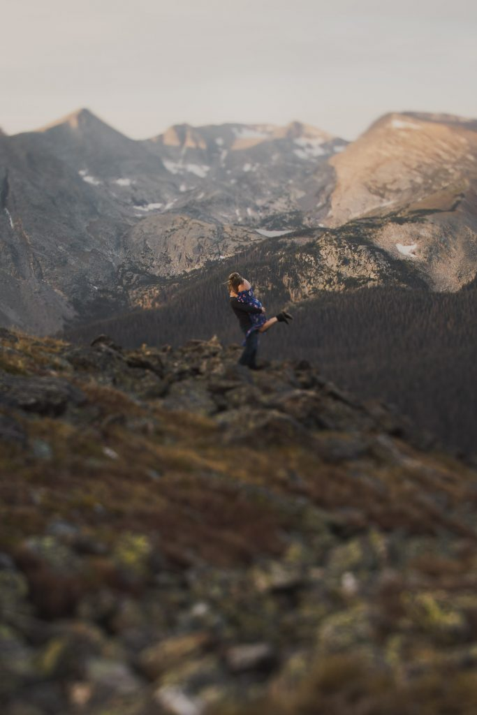 Colorado adventure Engagement photographer at sunrise in Rocky Mountains