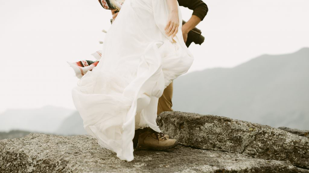 She explores and dances on the top of the boulder. Stories of life changing adventures on the top of the world Photos by Justyna E Butler Photography. Intimate Weddings + Adventure Elopement Photographer based in Colorado.