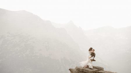 Colorado Alpine Adventures in Rocky Mountains were the adventurous souls embrace each other in the hummingbird shot, signature shot for Justyna E butler Photography, Intimate Weddings + Adventure Elopement Photographer