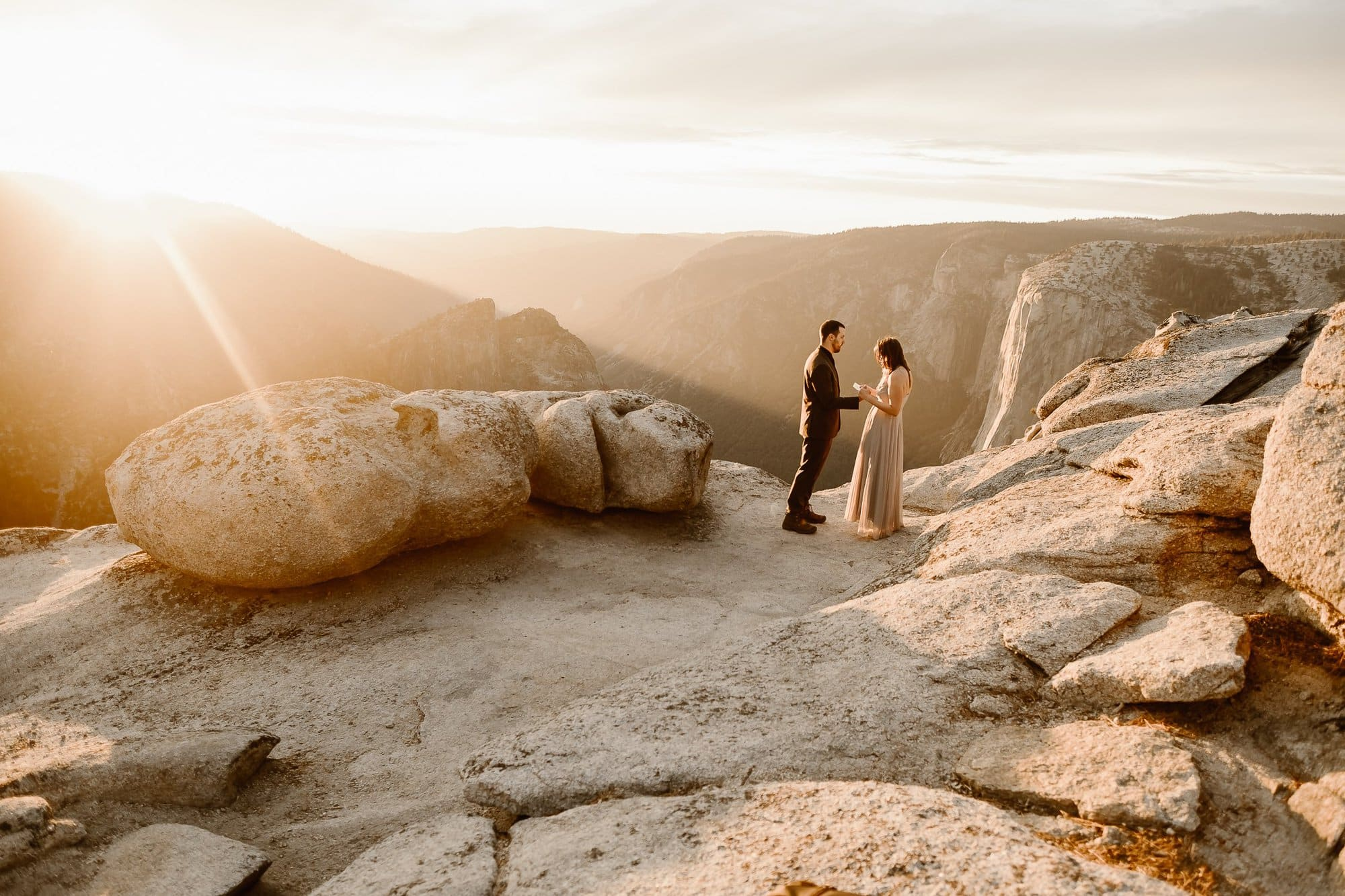 The vows renewal at Taft Point Yosemite National Park at golden hour sunset | ADVENTURE ELOPEMENT PHOTOGRAPHER | CALIFORNIA ADVENTURE ELOPEMENT PHOTOGRAPHER