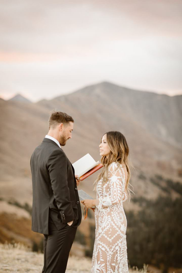 If you've been looking for idyllic destination wedding adventure inspiration, These two adventure souls Colorado Alpine adventure elopement wedding is everything you need to see today! Photos by Justyna E Butler Photography