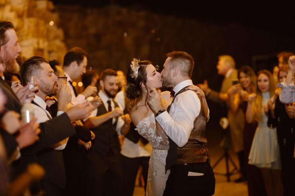 Exits after the most romantic day ever...deserves a KISS, DELLA TERRA MOUNTAIN CHATEAU COLORADO WEDDING | COLORADO WEDDING PHOTOGRAPHER | ESTES PARK COLORADO