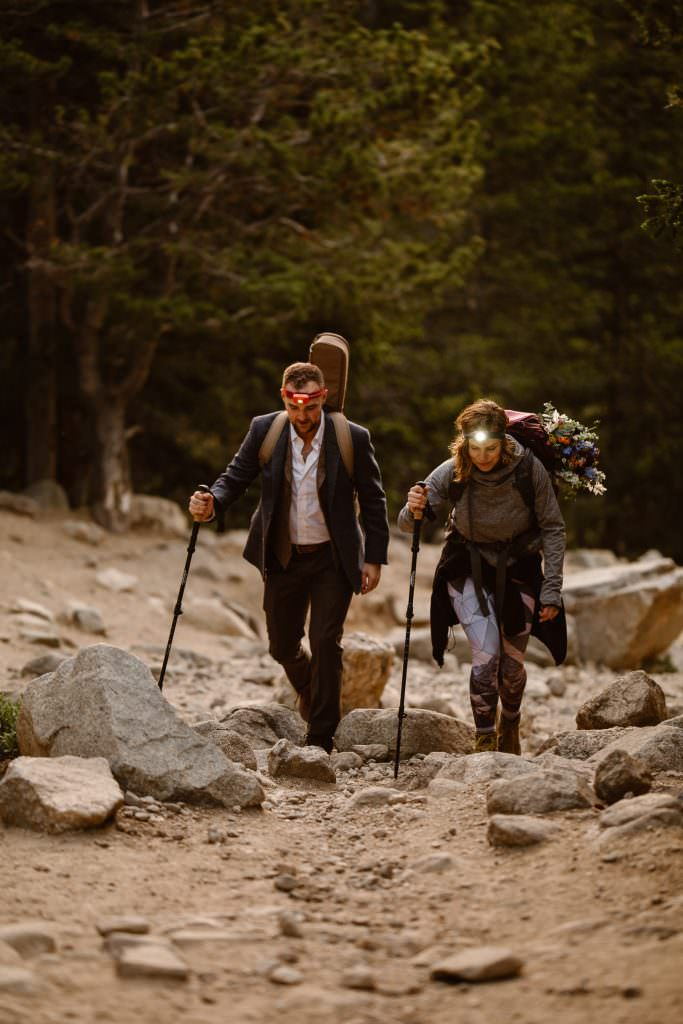Colorado Adventure Elopement Hiking, The bride and a groom, adventurous souls are hiking at sunrise with headlamps to elope at alpine lake here in Colorado trails. Photos by Justyna E Butler Photography, Colorado Adventure Elopement photographer, a light chaser for boho brides who love adventures