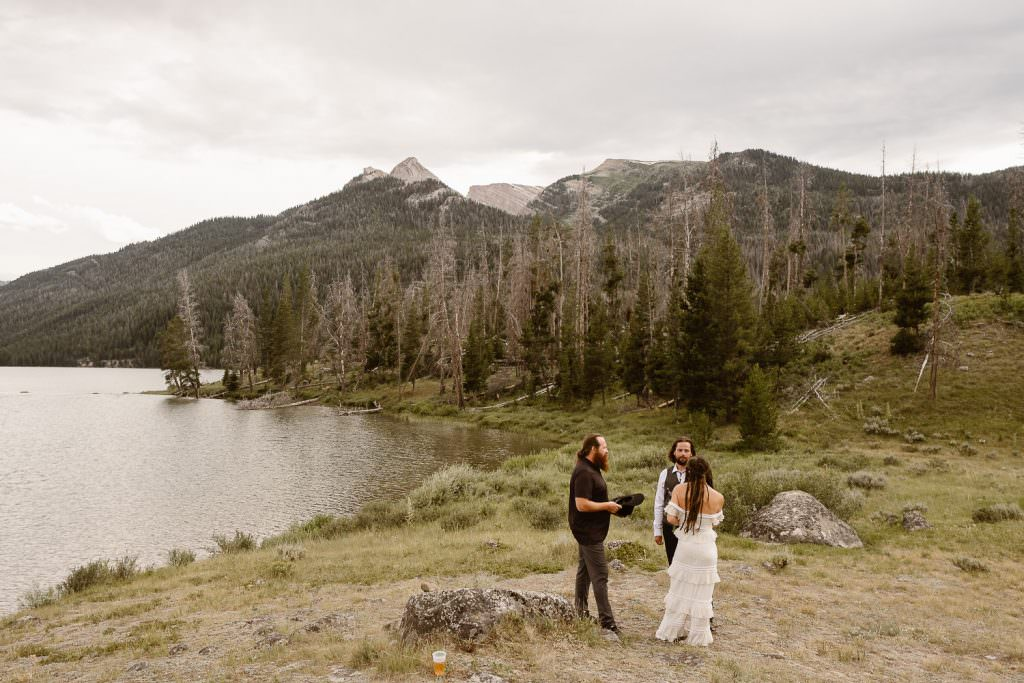 Ceremony at CDT Trail Bride + Cole TrailBride + Cole cheers to the newly weds at The CDT Trail HIKERS at Jamie + Nick Highline Trail Adventure Elopement | CDT Hiking Elopement | Continental Divide Trail Adventure Elopement | Destination Adventure Wedding Photographer | Wyoming Wind River Range Adventure Elopement | Jamie + Nick