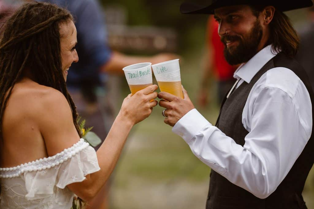 TrailBride + Cole cheers to the newly weds at The CDT Trail HIKERS at Jamie + Nick Highline  Trail Adventure Elopement | CDT Hiking Elopement | Continental Divide Trail Adventure Elopement | Destination Adventure Wedding Photographer | Wyoming Wind River Range Adventure Elopement | Jamie + Nick