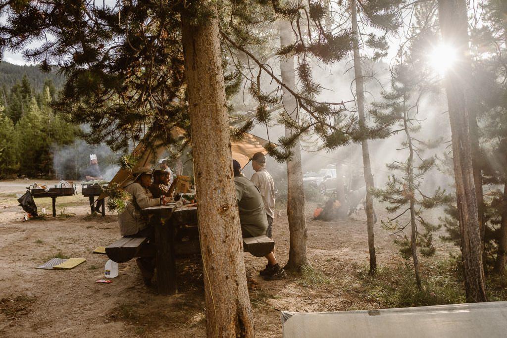 Bonfire snuggle of Jamie + Nick Highline Trail Adventure Elopement | CDT Hiking Elopement | Continental Divide Trail Adventure Elopement | Destination Adventure Wedding Photographer | Wyoming Wind River Range Adventure Elopement | Jamie + Nick