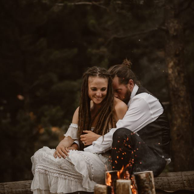 Bonfire snuggle of Jamie + Nick Highline  Trail Adventure Elopement | CDT Hiking Elopement | Continental Divide Trail Adventure Elopement | Destination Adventure Wedding Photographer | Wyoming Wind River Range Adventure Elopement | Jamie + Nick