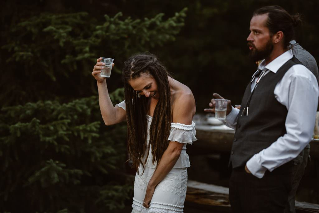 Toast at time at The adventure elopement couple reads the marriage license at Green River Adventure Backpacking Elopement Continental Divide Trail Adventure Elopement | Destination Adventure Wedding Photographer | Wyoming Wind River Range Adventure Elopement