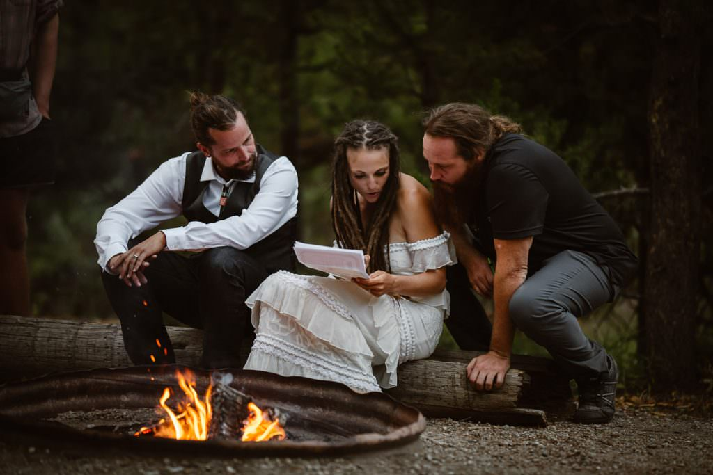 The adventure elopement couple reads the marriage license at Green River Adveture Backpacking Elopement Continental Divide Trail Adventure Elopement | Destination Adventure Wedding Photographer | Wyoming Wind River Range Adventure Elopement