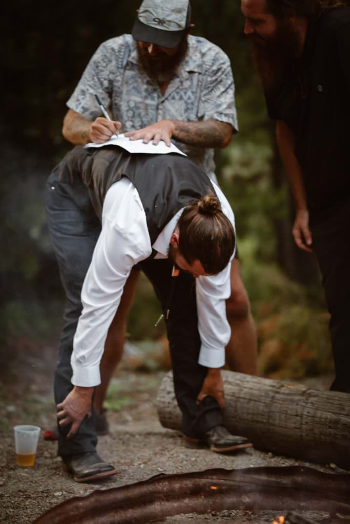 The best man, witness signs the marriage license for the couple at Green River Adveture Backpacking Elopement Continental Divide Trail Adventure Elopement | Destination Adventure Wedding Photographer | Wyoming Wind River Range Adventure Elopement