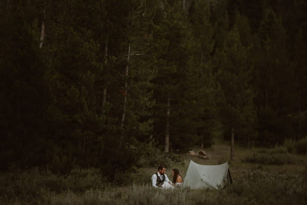 Highline Trail Adventure Elopement of the two adventurous souls enjoying a little time away from the guest at the camping area by the tent at Green River | CDT Hiking Elopement | Continental Divide Trail Adventure Elopement