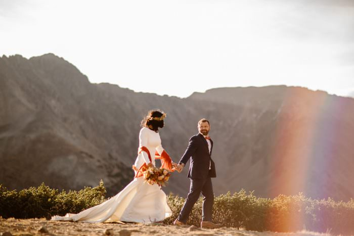 Adventure Elopement With Ethereal Alpine Rainbow Dream Backdrop during the Intimate Ceremony Vows in Rocky Mountains; Colorado Elopement Photographers